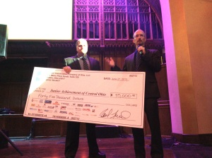 Junior Achievement of Central Ohio President, Mike Davis, graciously accepting a check of $45,000.