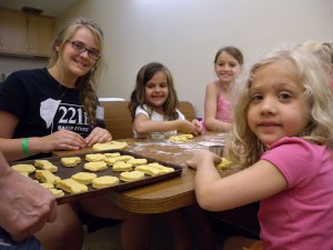 Campers and teen volunteers making homemade dog treats