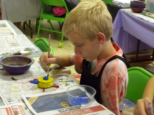 One of our campers concentrating on painting his Oaxacan animal