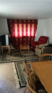 This apartment was bare before Fadumo came through and she decked it out in as traditionally Somali as possible AKA dark shades and oriental rugs