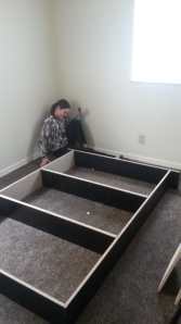 Here my boss Hannah and I are attempting to assemble a Queen size box spring without directions (yes we were successful).