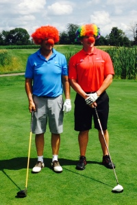 Dad & Son golfers clowning around!