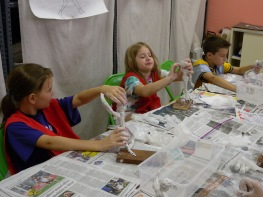 The campers made foil armatures of figures doing actions, like dancing, jumping, kicking, and running, and then covered them in plaster bandages, like sculptures by the artist George Segal.