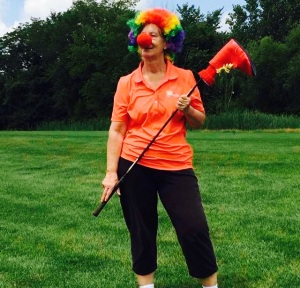 Another golfer clowning around with a Ronald's shoe putter head cover
