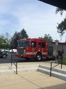 Firefighters on site at the Charitable Pharmacy immediately after a patient passed out on my last day.