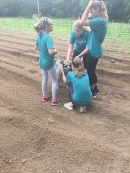 Milo, garden celebrity, and kids from Camp Project L.E.E.D.
